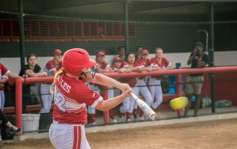 Softball slugs their way to a season-opening sweep