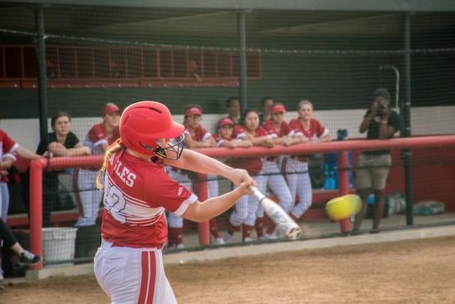 Softball slugs their way to a season-opening sweep