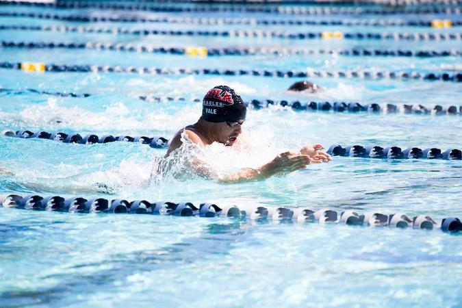 Swim teams dive into winter invite