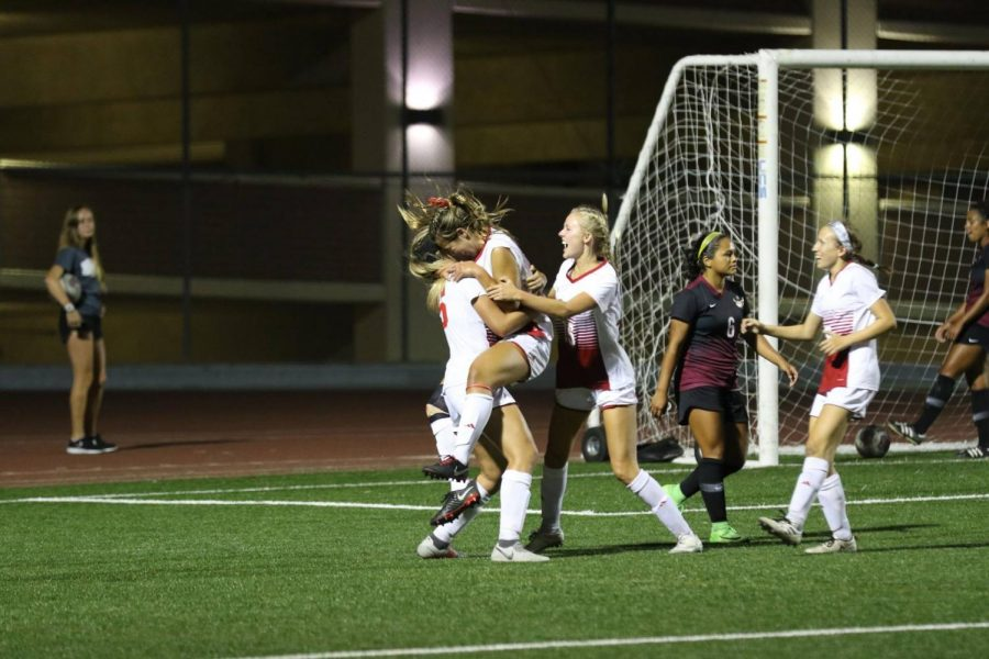 Junior forward AnnMarie Alvarez celebrates with Sarah Jeffries and Colie Martin after scoring the game-winning goal