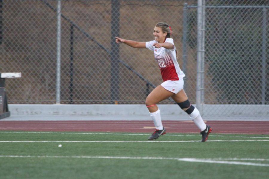 Annmarie Alvarez grins during a game