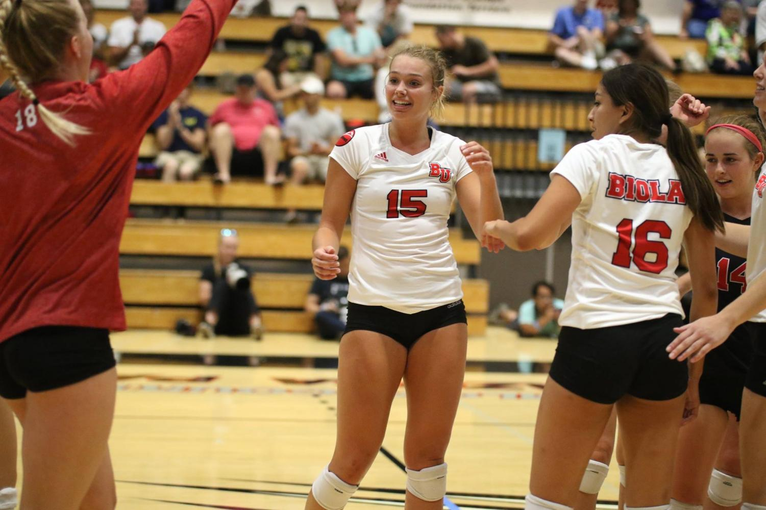 Sophomore outside hitter Christina DenBoer celebrates with her team during the Eagles' win over Sonoma State on Sept. 1. Courtesy George Rodriguez/Biola Athletics