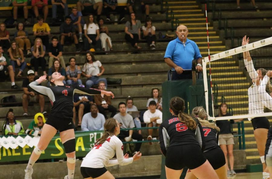 Junior outside hitter Sabrina Winslow readies for a kill while teammates look on during the Eagles game at Point Loma on Sept. 11.