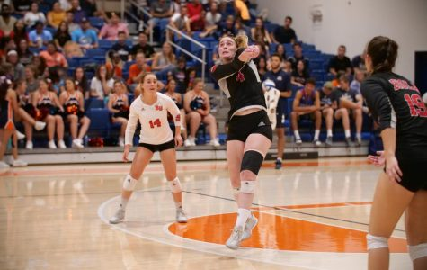 Junior outside hitter Sabrina Winslow (4) digs a ball out during the Eagles' game against Fresno Pacific on Sept. 28, 2018 as sophomore libro Sami Hover (15) and sophomore outside hitter Savannah Hilde (19) look on. Courtesy of George Rodriguez/Biola Athletics