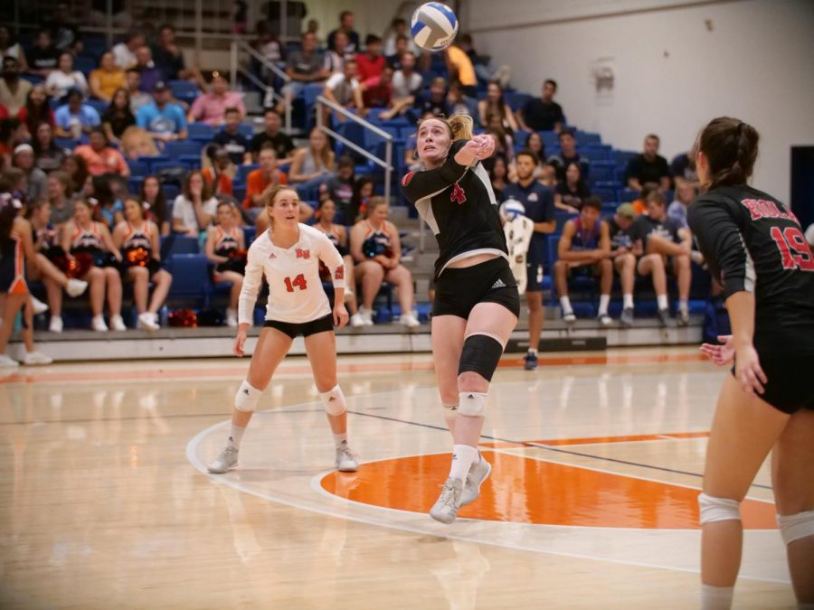 Junior+outside+hitter+Sabrina+Winslow+%284%29+digs+a+ball+out+during+the+Eagles%27+game+against+Fresno+Pacific+on+Sept.+28%2C+2018+as+sophomore+libro+Sami+Hover+%2815%29+and+sophomore+outside+hitter+Savannah+Hilde+%2819%29+look+on.+Courtesy+of+George+Rodriguez%2FBiola+Athletics