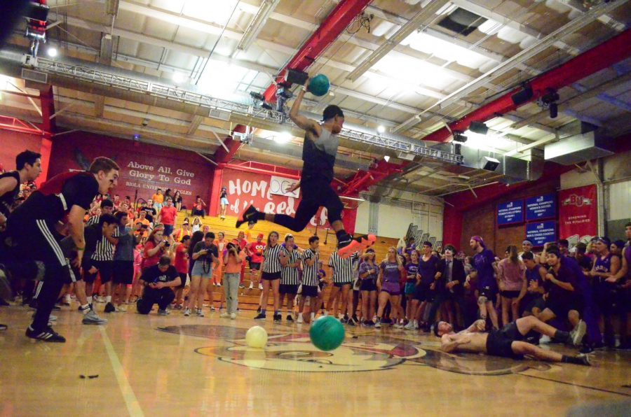 A horton resident leaps into the air with a dodgeball toward the off-campus community students