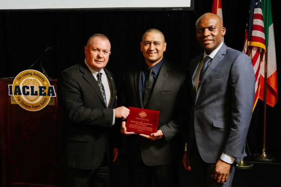 Sgt. Alvarez receiving his award alongside Chief John Ojeisekhoba