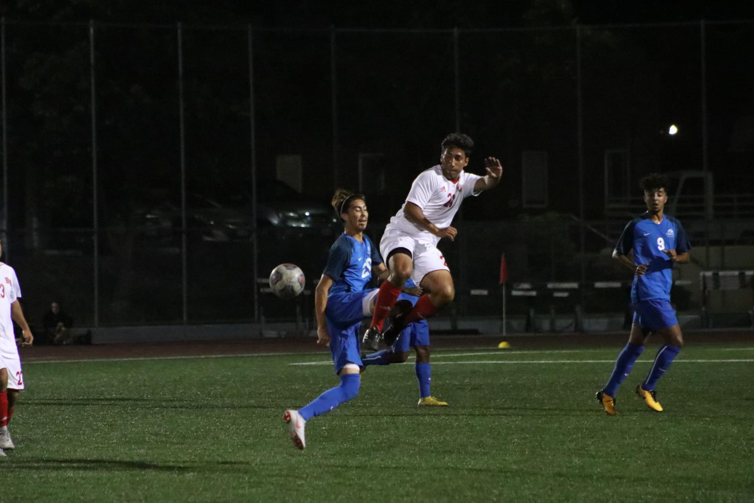 Freshman defender Henry Reeves makes a play over a CSUSB defender during the Eagles' 1-0 victory over the Coyotes on Sept. 8, 2018. Thecla Li/THE CHIMES