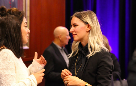 Brit Gilmore talks with a attendee during Crowell School of Business's startup competition kickoff on Sept. 17, 2018. Hannah Clark/THE CHIMES