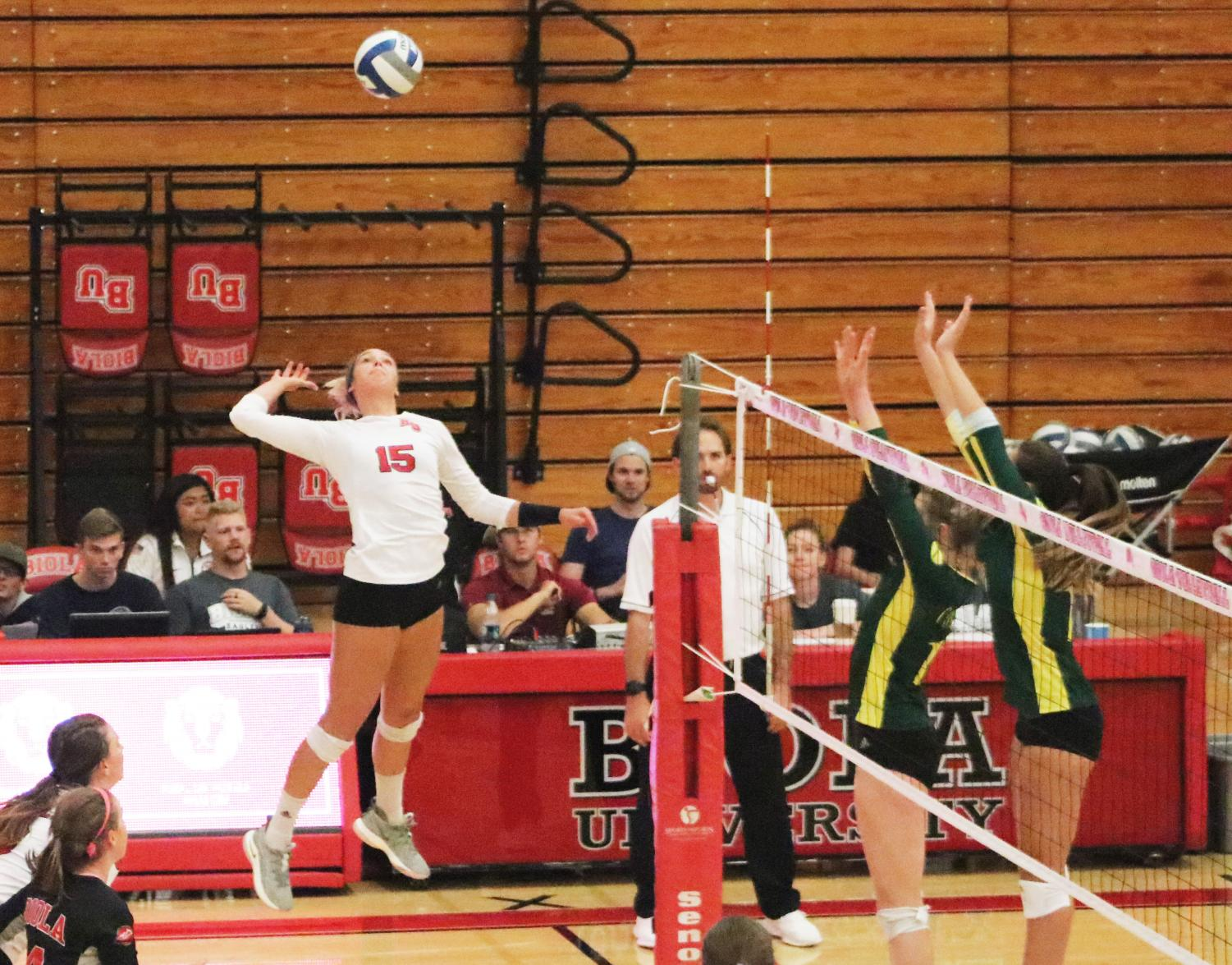 Outside hitter Christina DeBoer gets ready to spike the ball during Biola's game against Concordia University Irvine on Sept. 26, 2018. Photo by Thecla Li/ THE CHIMES