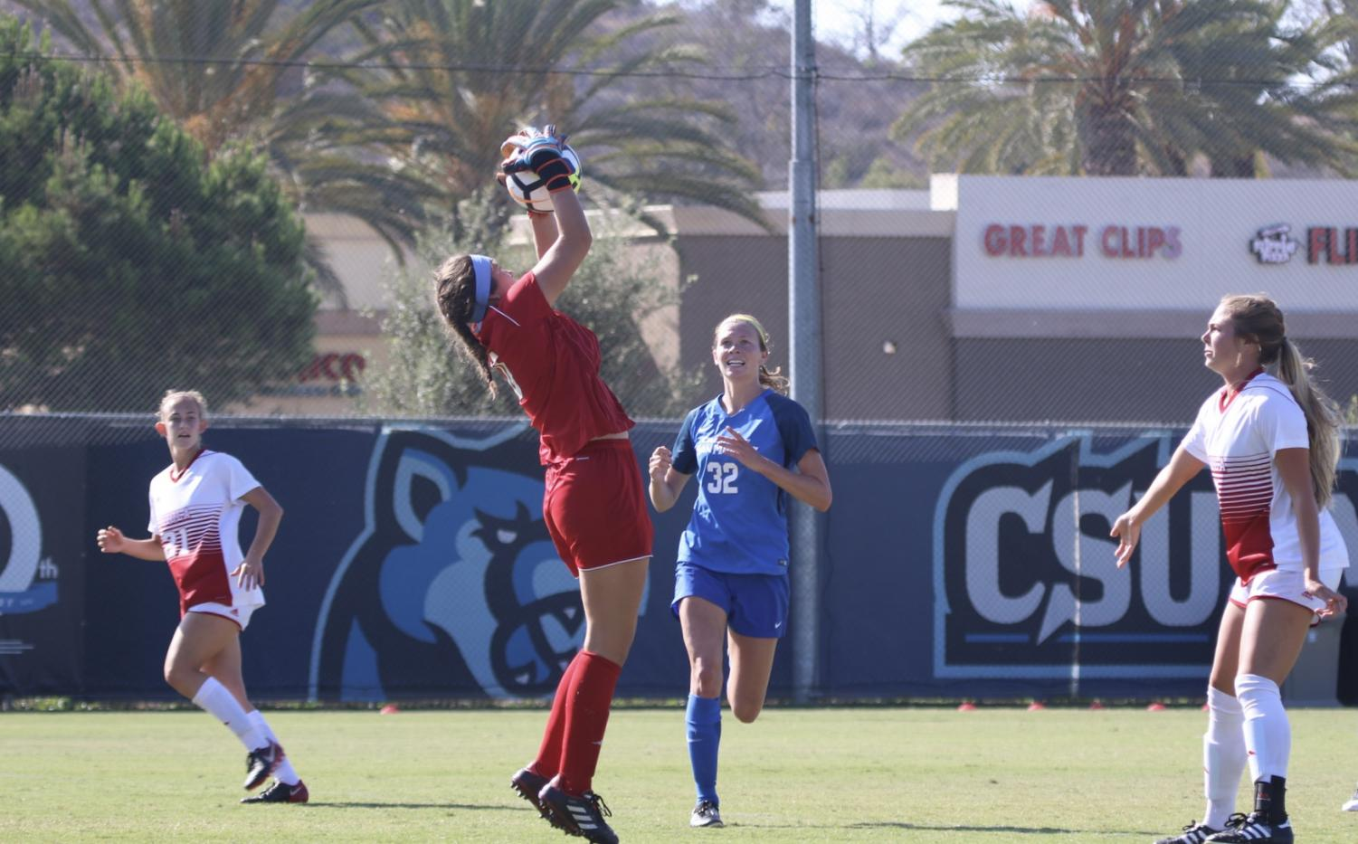 Sophomore goalkeeper Alyssa Joel (0) makes a save in overtime during the Eagles' game against Cal State San Marcos on Sept. 6, 2018. Courtesy George Rodriguez/Biola Athletics