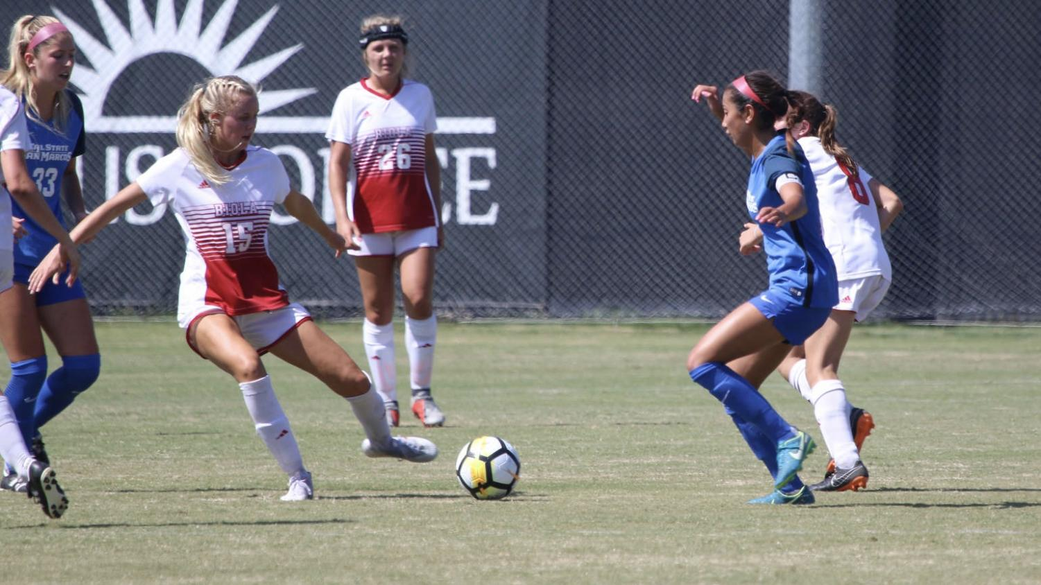 Colie Martin (15), Sarah Jeffries (16) and Katelyn Penner (8) fight for possession against Cal State San Marcos on Sept. 6, 2018. Courtesy George Rodriguez/Biola Athletics
