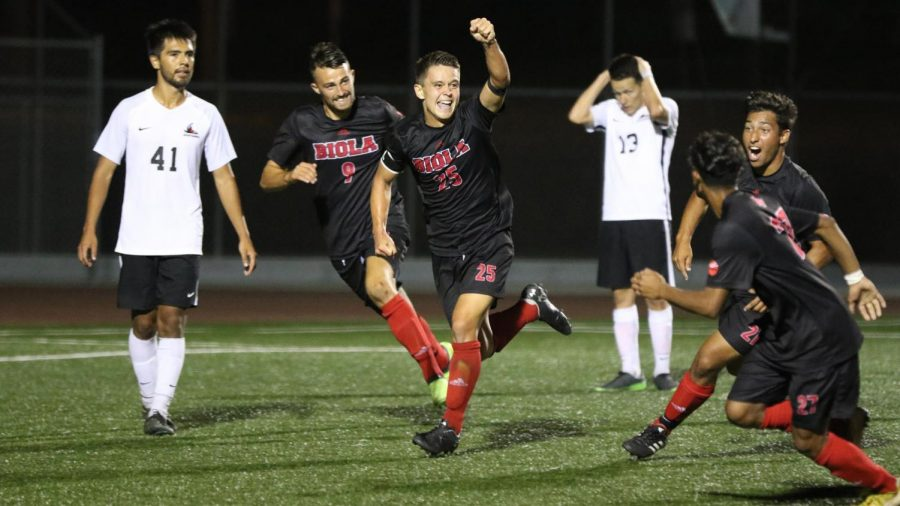 Senior midfielder Kousei Mattox (25) celebrates after scoring the game-winning goal to beat Northwest Nazarene University on Sept. 13, 2018. Courtesy of George Rodriguez/Biola Athletics