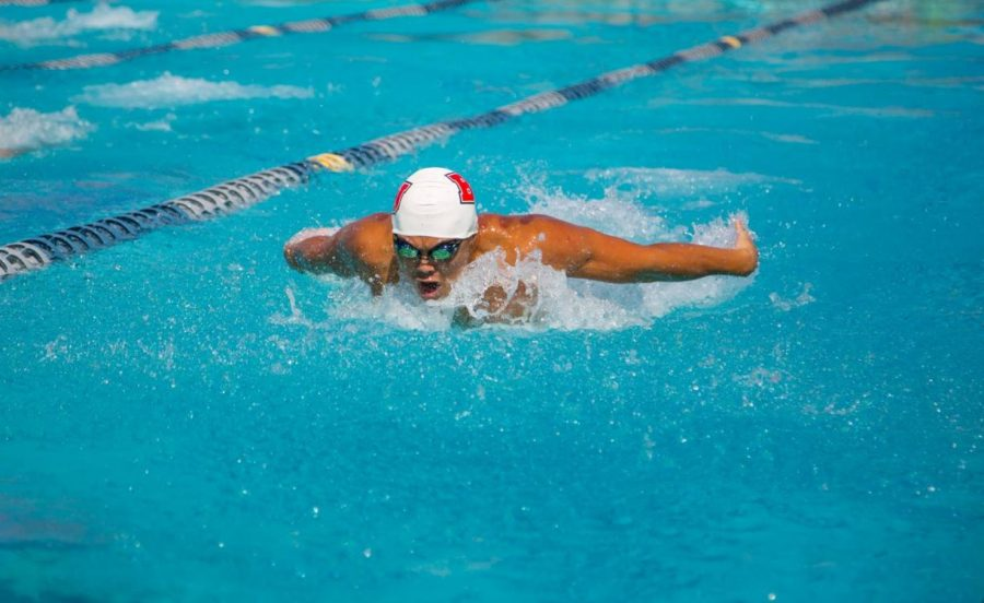 Junior Raymond Kam swims during the PCSC Relay Meet on Oct. 5, 2018. Photo courtesy of Adam Washington / Biola Athletics