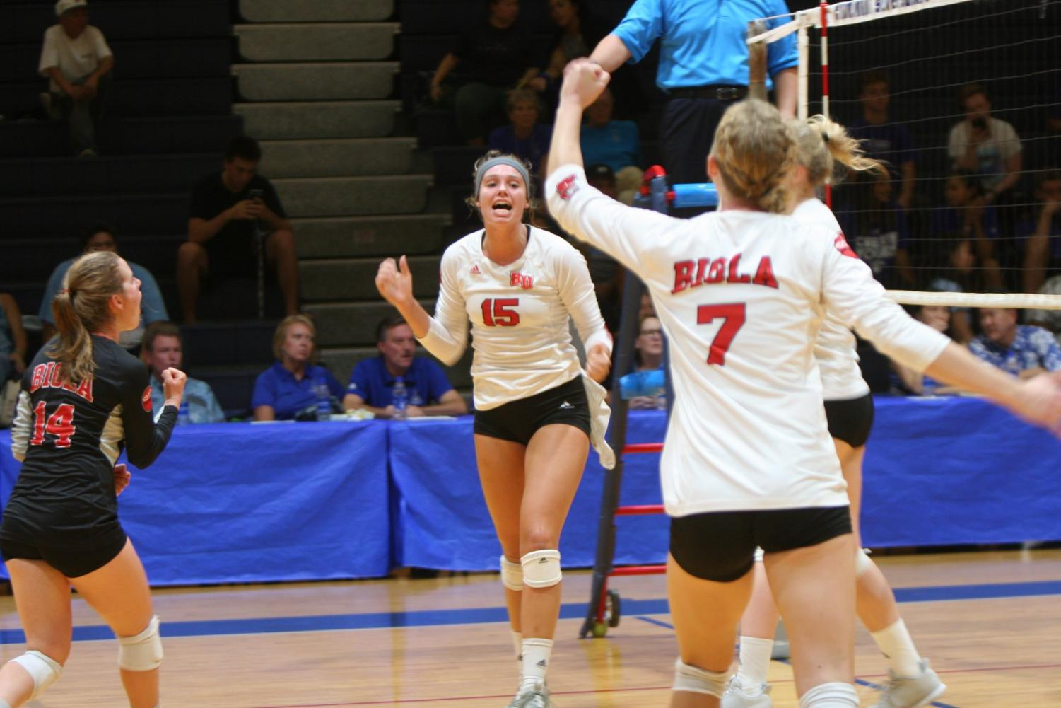 Redshirt sophomore outside hitter Christina DenBoer (15) celebrates during her teammates during Biola's win over Chaminade Oct. 9, 2018.