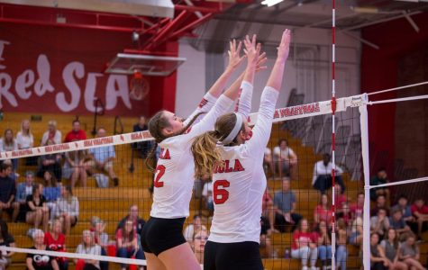 Senior middle blocker Sierra Bauder and senior setter Brinley Beresford go up for a block against Point Loma on Oct. 26.