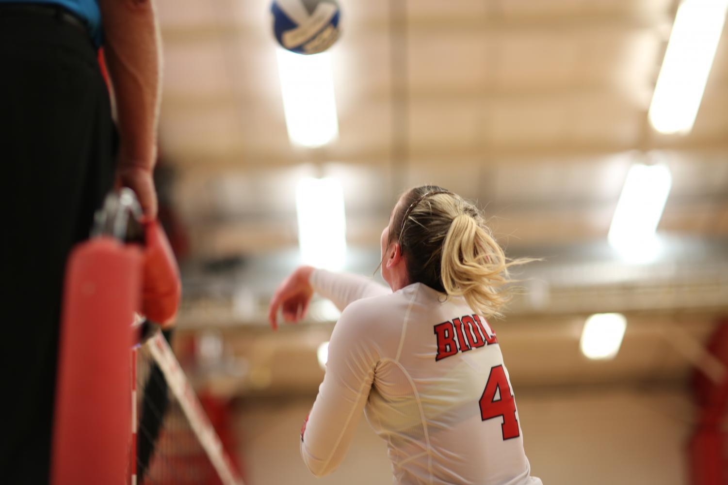 Junior outside hitter Sabrina Winslow goes for a kill in this file photo from Oct. 3, 2018.