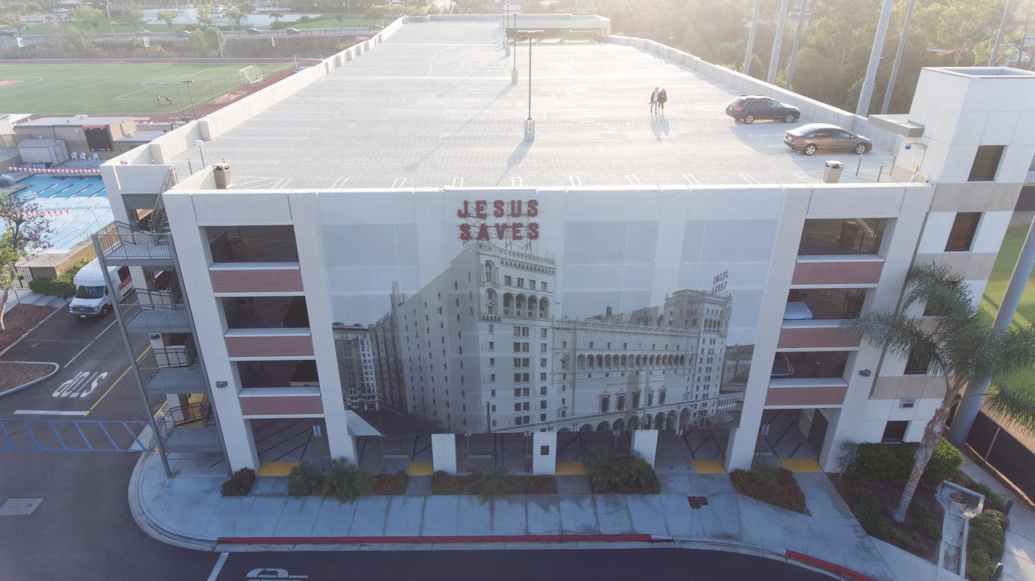 Photo depicts a birds eye view drone image of the Jesus Saves Parking Structure