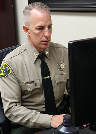 Capt. James Tatreau of the Norwalk patrol station helps coordinate deputies who respond to calls involving individuals who may have a mental illness.  His department, like many others, has seen a significant increase in mental illness reports.