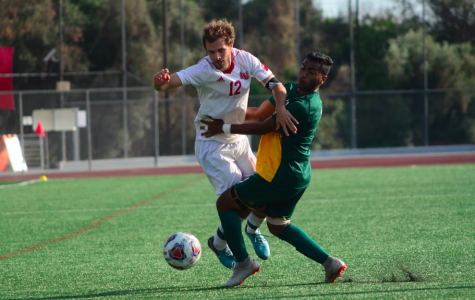 Senior defender Parker Setran battles for a loose ball during Biola's game against Concordia University Irvine on Oct. 6, 2018. Photo by Abram Hammer / THE CHIMES