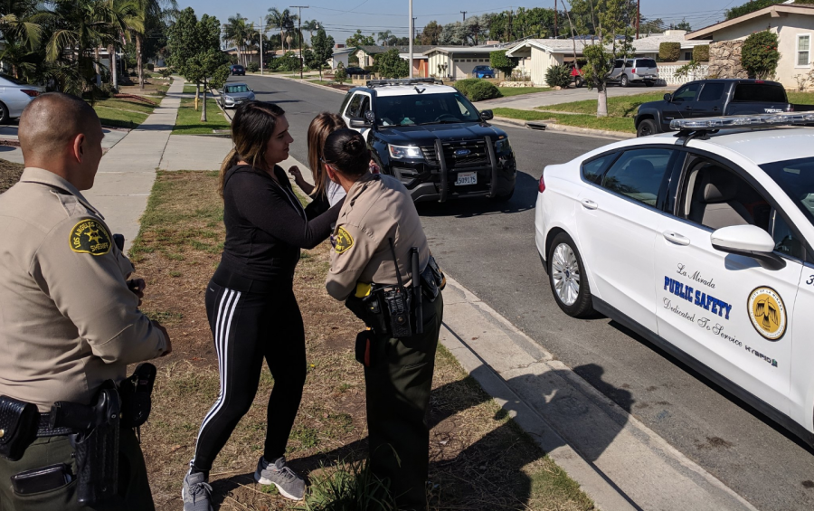 Los Angeles County sheriff's deputies from the La Mirada substation return a 3-year-old girl to her mother on Oct. 26, 2018.