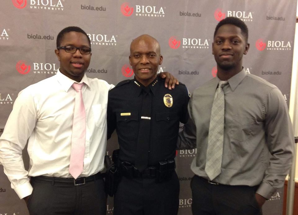 Moses Sambo (left) congratulates his uncle, Campus Safety Chief John Ojeisekhoba (middle), for receiving the Campus Safety Director of the Year award in 2015, with Sambo's brother on the right. Sambo died two years later, in Sept. 2017.