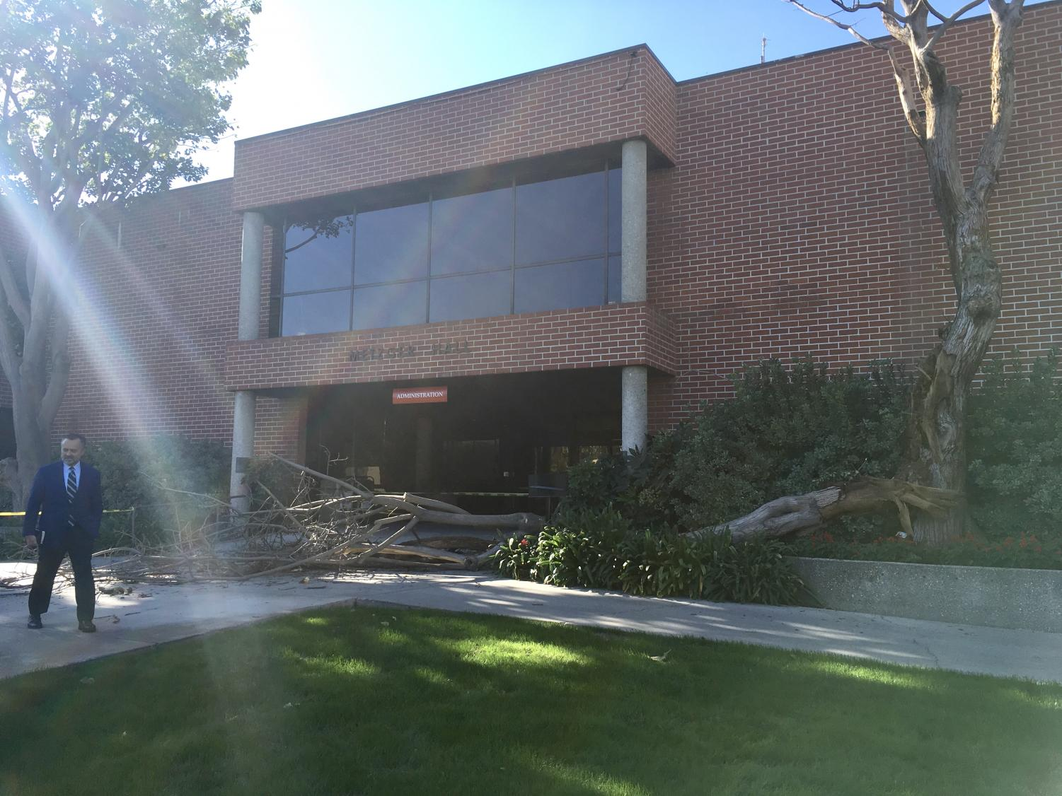 President Barry Corey walks away from the entrance of his workplace, Metzger Hall, after a tree fell in front the building on the morning of Nov. 9.