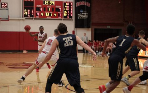 Men's basketball wins their season's first PacWest game