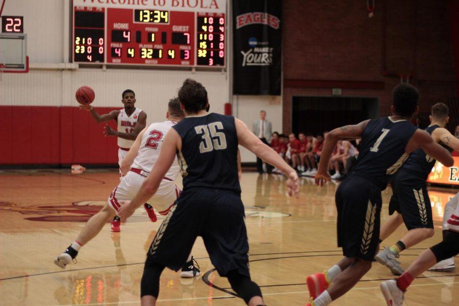 Men's basketball wins their season's first PacWest game