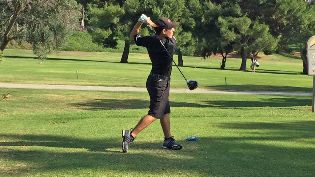 Senior Dominic Ariondo tees off during the Eagles' dual match against the University of La Verne on Nov. 7.