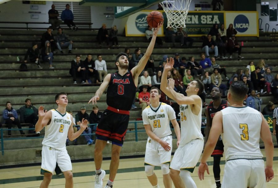 Sophomore forward Michael Bagatourian attempts a layup during the Eagles' 82-54 loss at Point Loma on Dec. 5, 2018.