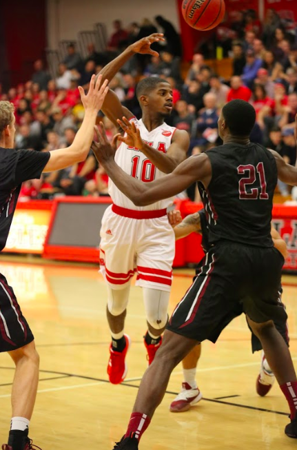 Freshman+guard+Alex+Wright+takes+a+shot+during+a+game+against+Azusa+Pacific+University+on+Dec.+15.