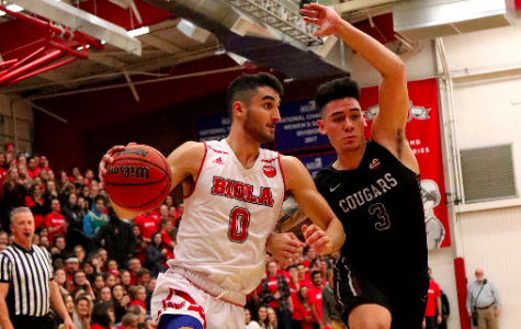 Sophomore guard Michael Bagatourian dribbles through the court in a game against Azusa Pacific University on Dec. 15.