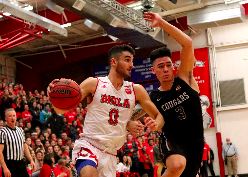 Sophomore+guard+Michael+Bagatourian+dribbles+through+the+court+in+a+game+against+Azusa+Pacific+University+on+Dec.+15.