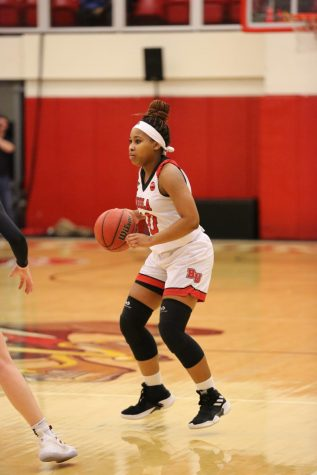 Women's basketball survives overtime thriller