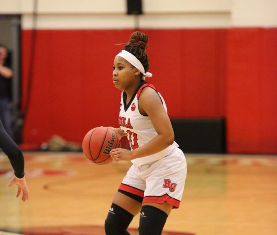 Junior guard Tatum Brimley dribbles during Biola's loss to APU on Dec. 15, 2018. The Cougars also won the rematch of the two rival schools on Jan. 19.