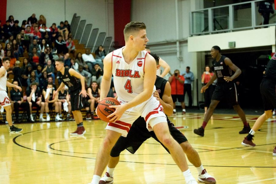 Sophomore guard Will Shannon tries to get past his defender during Biola's loss to APU on Dec. 15, 2018. The Cougars also won the rematch of the two rival schools on Jan. 19.