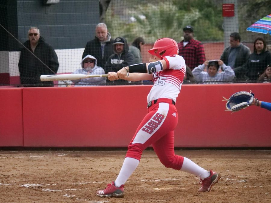 Junior catcher Kayla Neff swings at a pitch during the Eagles' game against Cal State San Marcos on Feb. 10. The game was eventually suspended due to rain.