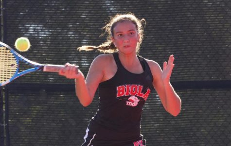 Women's tennis wins big in first match of the season