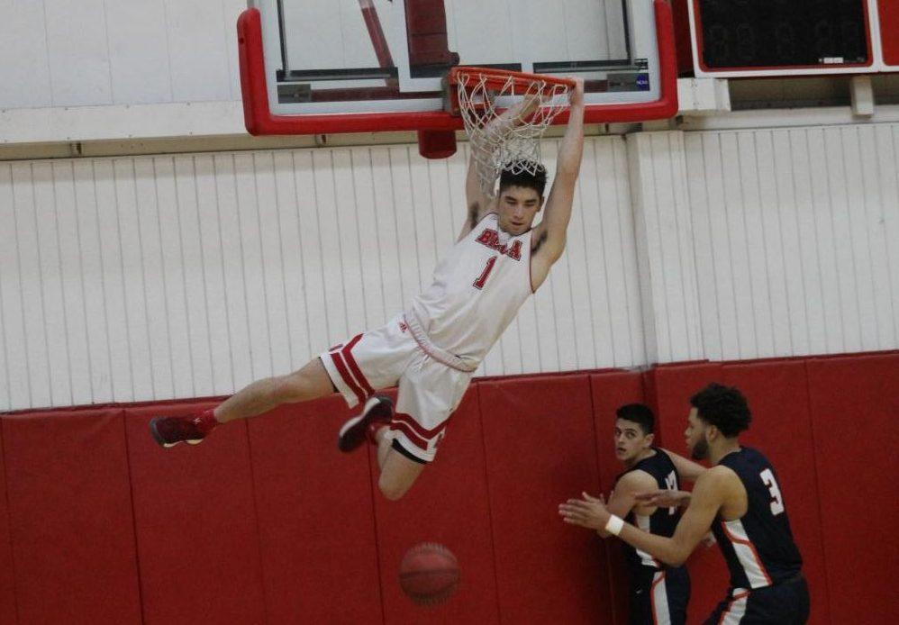 Trevor Treinen dunks during Biola's win over Fresno Pacific University on Jan. 31.
