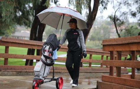 Women's golf competes through downpour