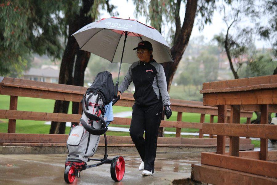 Women's golf competes through downpour
