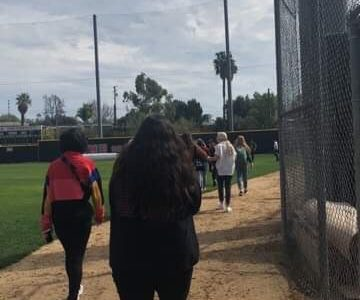 Students walk to the baseball field after being evacuated from lower campus due to a major gas leak.