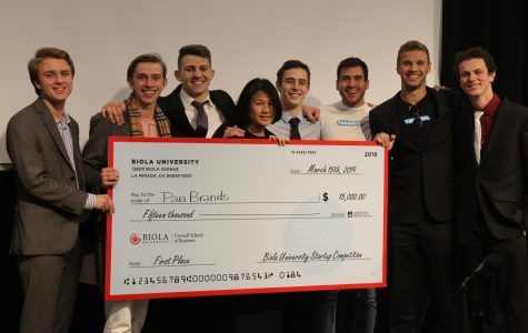 The parabrands team receives their first-place check
