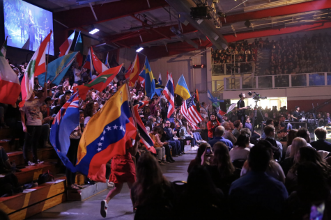 students wave country flags for missions conference