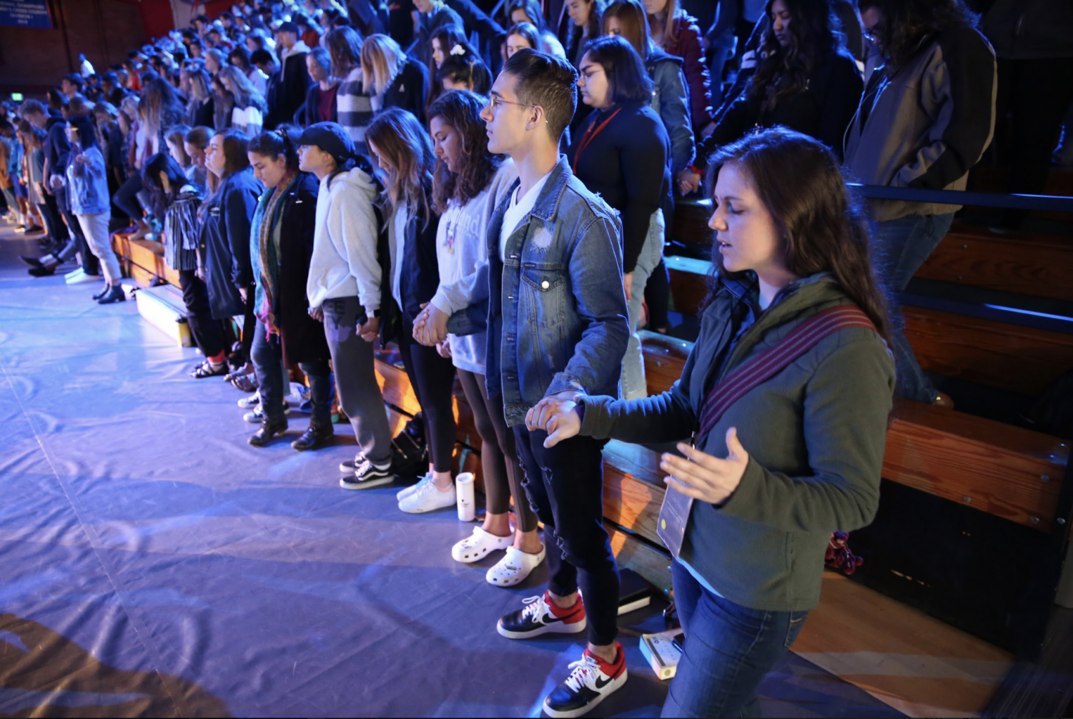 Students join hands in prayer at Missions Conference Day 2.