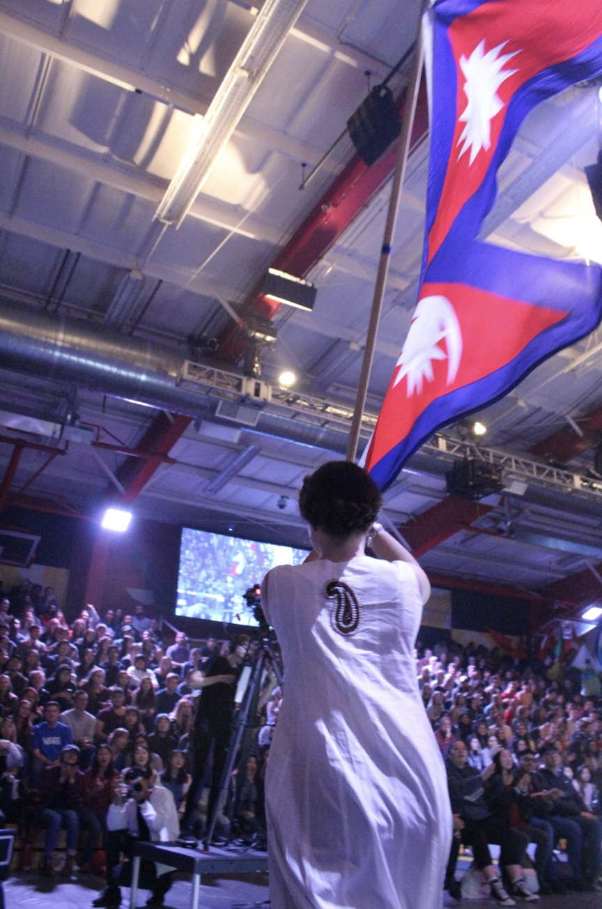Students+in+traditional+Nepalian+clothing+carries+the+flag+of+Nepal+in+the+Parade+of+Nations.