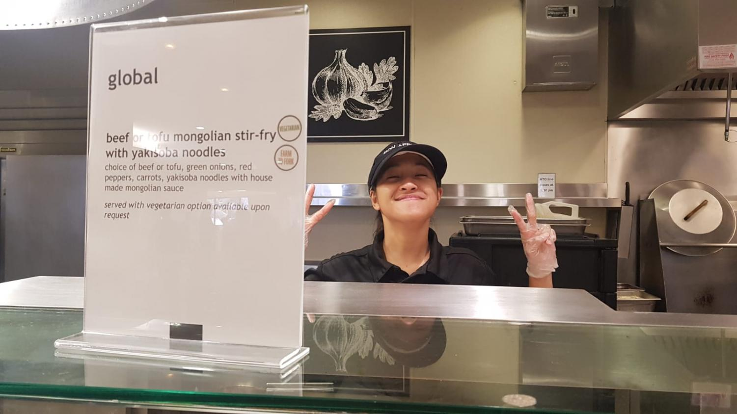 International Indonesian student Jovie Sylvania poses for the camera at her caf station.