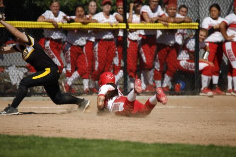 Softball splits rough doubleheader