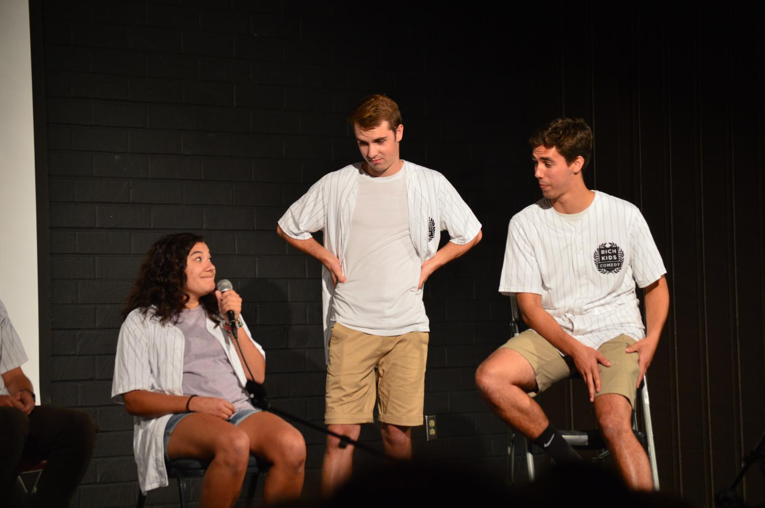 Psychology major Carissa Tereba, communications studies major Landon Hawley, and engineering physics major Josh Bernstein perform their comedy act in Mayers Auditorium on September 13, 2019.